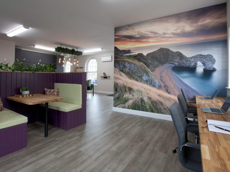 Rear view of Purple Office including flexible desk hire, private booth seating for interviews and a view of Durdle Door