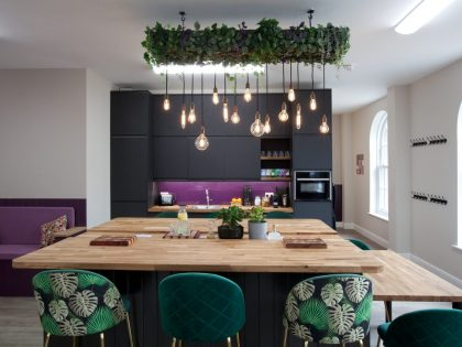 A shot of the open plan space at Purple Office in Poundbury, showing the kitchen, island unit and beautiful decor.
